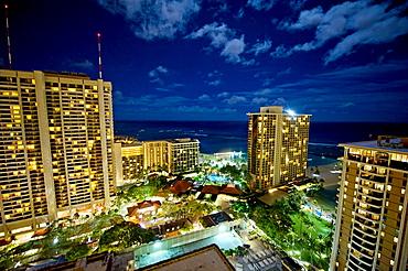 Waikiki tourist area at night, Honolulu, Hawaii.