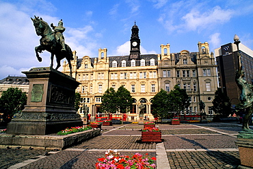 Beautiful flowers in the city square and statue of the Black Prince of Leeds England.