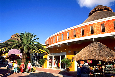 Tourists and at Puerta Maya Harbor Shops in Cozumel Mexico.