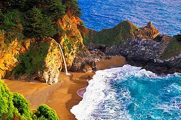 Evening light on McWay Cove and Waterfall, Julia Pfeiffer Burns State Park, Big Sur Coast, California USA.