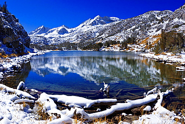 Fresh snow on Mount Abbot from Long Lake, John Muir Wilderness, Sierra Nevada Mountains, California USA.