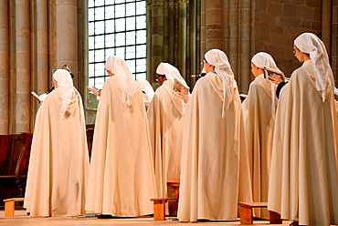 praying nuns in the cathedral of Vezelay in France