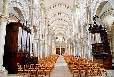 interior with organ player at the cathedral of Vezelay in France