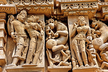 Erotic sculptures, Khajuraho Group of Monuments, UNESCO World Heritage Site, Madhya Pradesh, India, Asia.