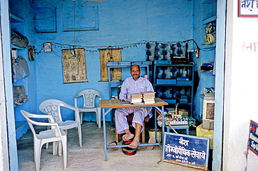 A doctor waiting for patients, Orcha, Madhya Pradesh, India, Asia.