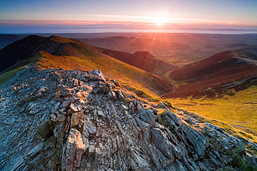Looking down Hope Gill from the summit of Hopegill Head at sunset in the Lake District. Whiteside to the left and Ladyside right.