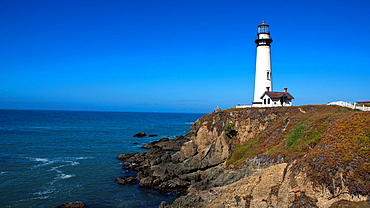 Pigeon Point Lighthouse on top of cliffs above the Pacific Ocean, Pescadero, California, United States of America.