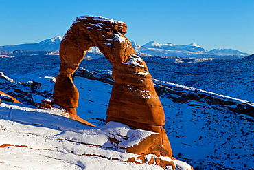 Delicate Arch with snow in winter at sunset, Arches National Park, Utah, United States of America.