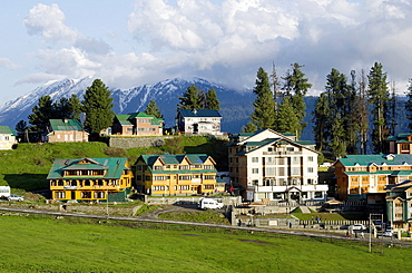 Hotels and Himalayan range, Gulmarg, Jammu & Kashmir, India.