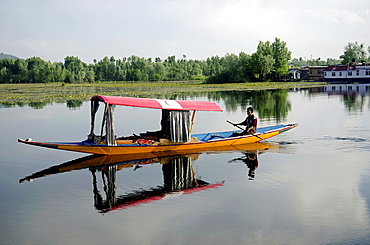 Shikara or house boat in Nageen lake, Srinagar, Jammu & Kashmir, India.