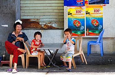 Joyful Children in the Streets of Ho Chi Minh City, Vietnam.