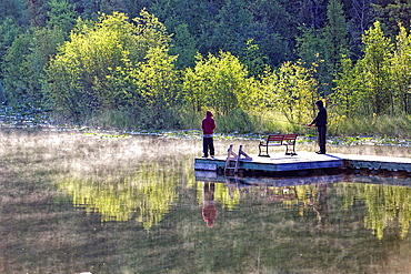 Two fishing boys at Jewel lake in the Rocky Mountains, Greenwood, British Columbia, Canada.