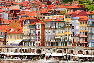 waterfront houses shops and cafes Cais da Ribeira Porto Portugal.