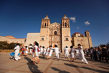 Dancers wearing traditional dresses performing in front of the Santo Domingo Church, Oaxaca, Mexico, North America.