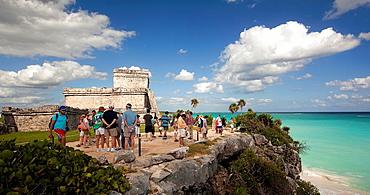 El Castillo and the rocky beach with the visitors at Mayan Ruins, Tulum, Quintana Roo, Yucatan Peninsula, Mexico.