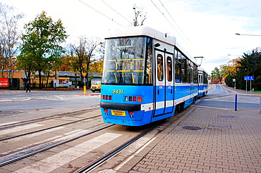 Wroclaw, Poland, November 10, 2013, Blue tram passing a intersection at the center of the city.