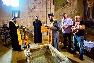 Georgia, Mtskheta City (W.H.), Sveti Tskhoveli Cathedral, Baptism ceremony.