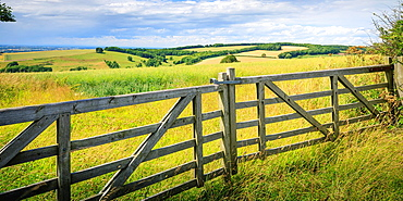 Field gateway, view across farm land and countryside. East Riding of Yorkshire. England.