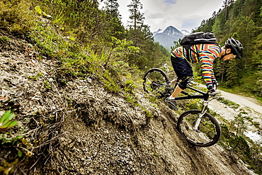 Mountain biker riding down mountain