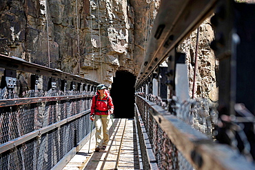Female hiker walking footbridge, Grand Canyon, Flagstaff, Arizona, USA
