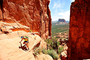 Female hiking rock formation in Sedona, Arizona, USA