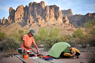 Backpacking couple making camp, Apache Junction, Arizona, USA