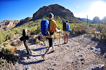 Backpacking couple hiking in Superstition mountains, Arizona, USA