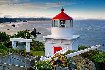 Trinidad Memorial Lighhouse overlooking fishing boats anchored in the ocean, Trinidad, California.