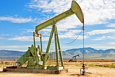 Oil well with pump at Kern Co. California.