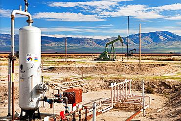 Petroleum facility_oil wells w pumps _Kern Co. CA H.