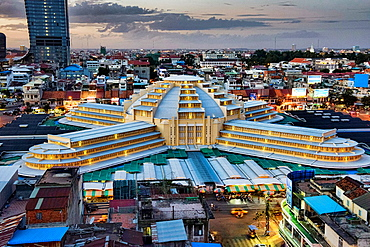 aerial view of the Art Deco Psar Thmei Central Market, Phnom Penh Tower, and city skyline, Phnom Penh, Cambodia.