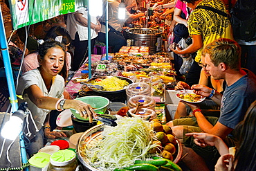 Spicy som tam papaya salad at the night market on Walking Street, Chiang Mai, Thailand.