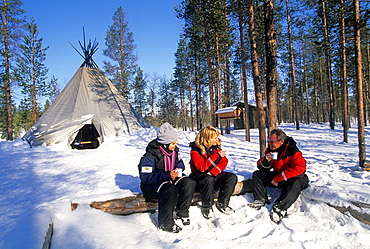 bivouac during a snowmobile trip around Ivalo, Lapland, Finland, Northern Europe.
