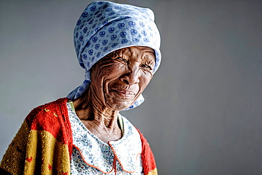 Portrait of an old bushmen woman looking strait to the camera, Aroab, Namibia, Africa.