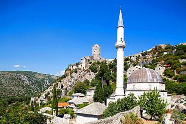 mosque and gavrankapetan tower, pocitelj, ancient town, bosnia and herzegovina, europe.