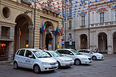 Taxis at Piazza Palazzo di Citta square central Turin city Piedmont region northern Italy Europe.