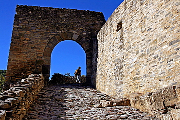 Cobbled road and arch, Montanana, Huesca, Spain