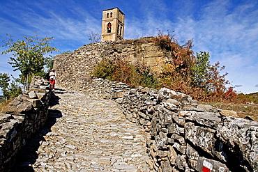 Cobbled road and Romanesque Church of Santa Maria de Baldos, Montanana, Huesca, Spain