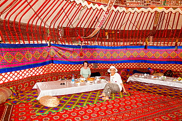 Tourists dining in a yurt, Ayaz Kala Yurt Camp, Ayaz Kala, Khorezm, Uzbekistan.