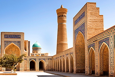 Kalon Mosque courtyard, also known as Kalyan Mosque, Kalon Minaret and Mir I Arab Madrasah behind, Bukhara, Uzbekistan.