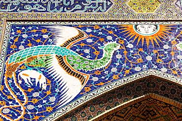 Mosaic on front of Nadir Divan Begi Madrasah, also known as Nadir Divan Beghi Madrasah, Bukhara, Uzbekistan.