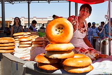 Woman selling non bread, Siyob Market, also known as Siab Market, Samarkand, Uzbekistan.