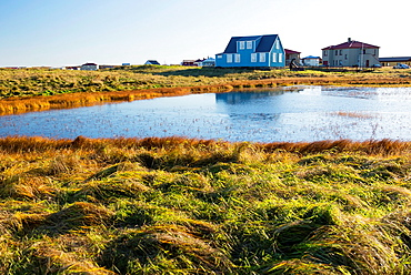 Sandgerdi village and lake in autumn. Iceland.