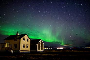 Northern lights in Reykjavik harbour, Iceland.
