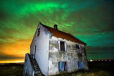 Warehouse by night in Kalfatjarnarvollur, Iceland.