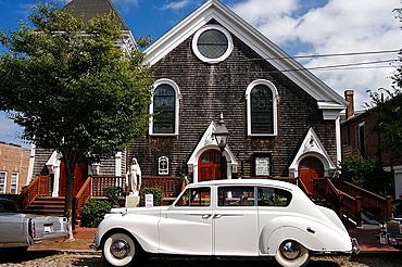 North America, USA, Massachusetts, Nantucket. A classic white car outside a shingled church.