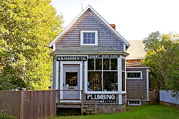 A business in an old shingled building on Nantucket, Massachusetts, United States.