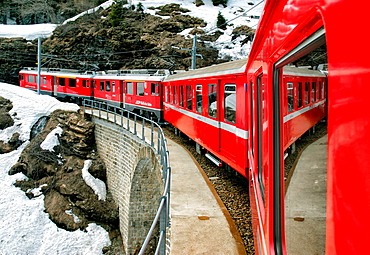 famous Bernina express train recorded in the list of UNESCO World Heritage for the beauty of the route, it is also highest adhesion railway of the continent, and - with inclines of up to 7% - as one of the steepest adhesion railways in the world, Grisons canton, Switzerland, Europe.