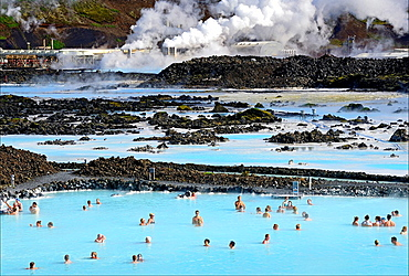 Blue Lagoon mineral hot springs bath, Svartsenga Geo-Thermal Plant in the background, close to Keflavik, Iceland, Polar Regions.