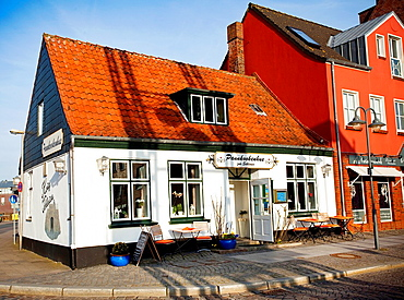 Facade of a restaurant in the center of Husum, North Friesian Islands, Schleswig-Holstein, Germany, Europe.